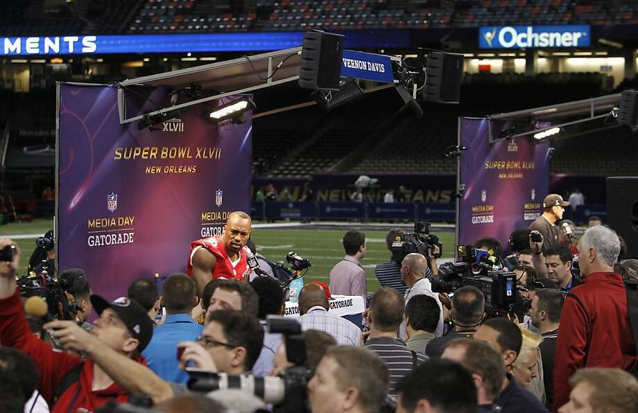 49er Vernon Davis,84 speaks with reporters as Media Day gets underway at the Mercedes-Benz Superdome the site of this year's Superbowl between the San Francisco 49ers and the Baltimore Ravens in New Orleans, La. on Tues. Jan. 29, 2013. Photo: Michael Macor, The Chronicle