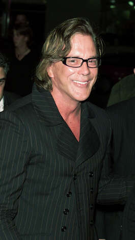 Mickey Rourke -- the two faces of Mickey.  Like two different actors.  I like them both. Photo: Kevin Winter, Getty Images / Getty Images North America