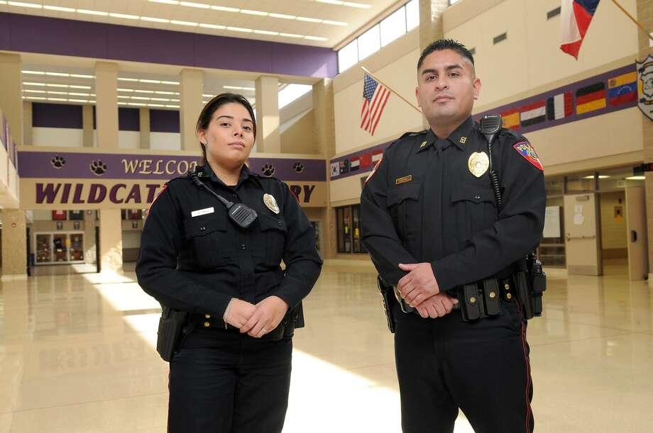 Humble ISD police officers Amy Cruz and Jose Sanchez work security at Humble High School. Photo: Jerry Baker, Freelance