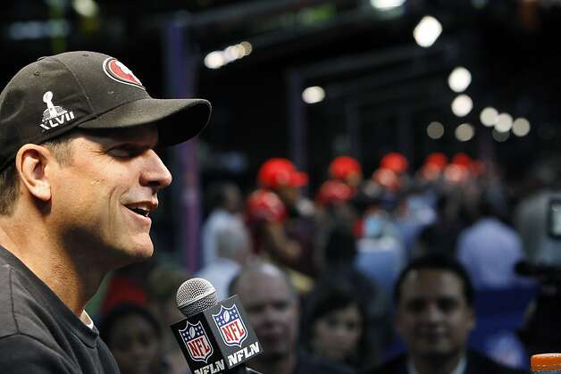 49ers coach Jim Harbaugh smiles as he answers a question from the press with his players behind him as the 49ers attended media day at the Super Dome in New Orleans, La., on Tuesday, January 29, 2013, as part of the Super Bowl festivities. Photo: Carlos Avila Gonzalez, The Chronicle