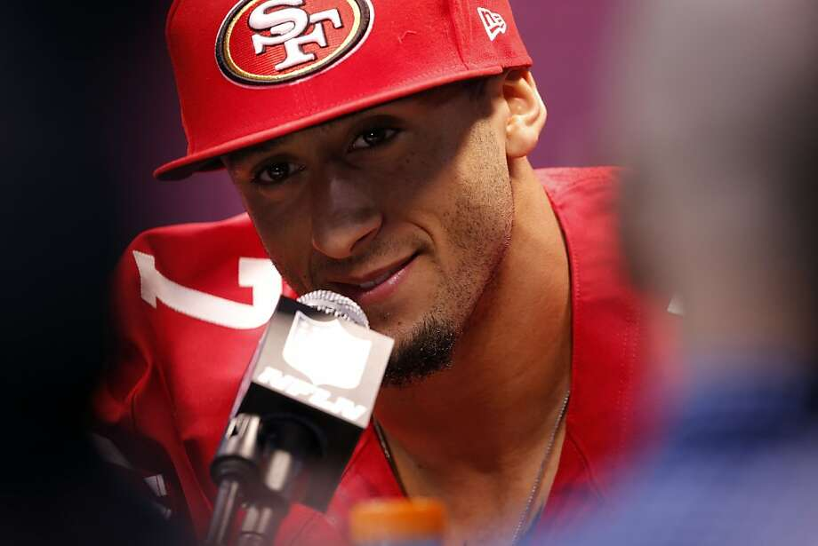 Colin Kaepernick smiles as he listens to a question from the press as the 49ers attended media day at the Super Dome in New Orleans, La., on Tuesday, January 29, 2013, as part of the Super Bowl festivities. Photo: Carlos Avila Gonzalez, The Chronicle