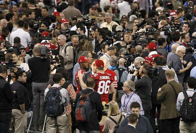 The 49ers' A.J. Jenkins and Brian Jennings (86) are surrounded by a mass of humanity during Media Day in the Superdome. Photo: Michael Macor, The Chronicle