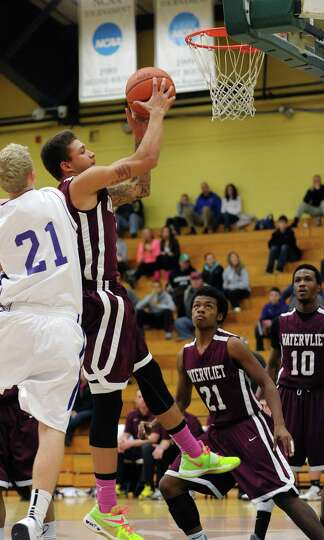 Jordan Gleason of Watervliet pulls down a rebound during their game against Voorheesville at the Sie