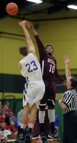Tyler McLeod, right, of Watervliet goes up for a jump ball during their game against Voorheesville a