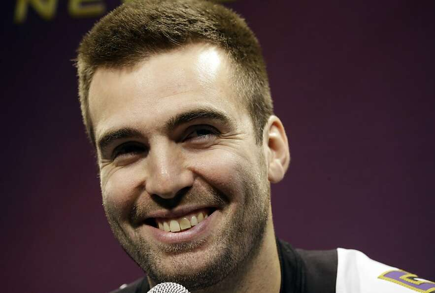 Baltimore Ravens quarterback Joe Flacco smiles during media day for the NFL Super Bowl XLVII footbal