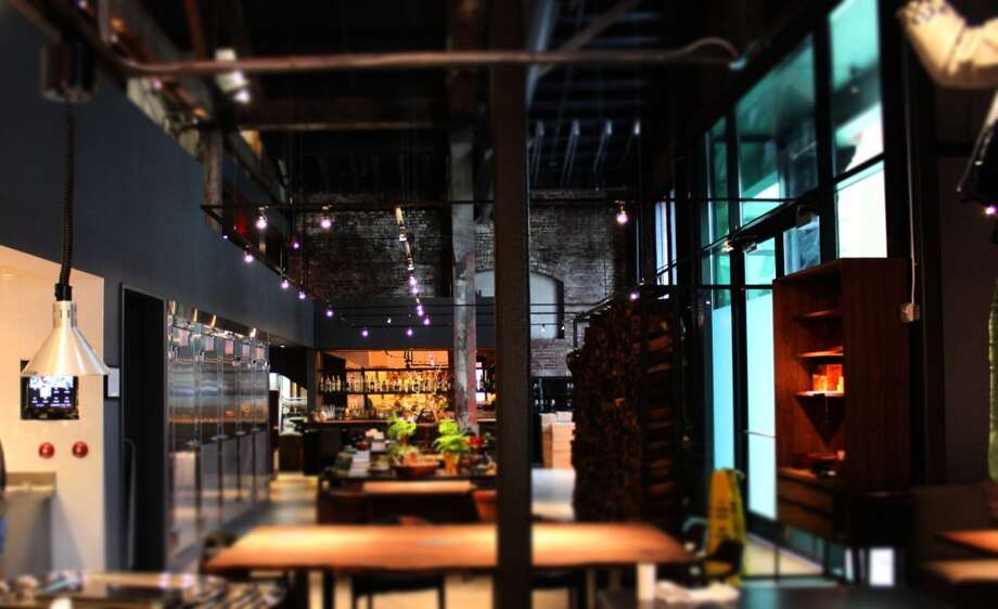 The view towards the bar from the kitchen, spanning the dining room. Townsend Street entrance to the right.
