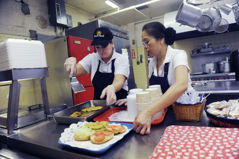 Chiefs Toni Deenihan, left, and Erlinda Haviland, make a a new lunch pilot program at Mianus School in North Mianus, Conn., Tuesday, Jan. 29, 2013. Starting next month at North Mianus School new food made from scratch. Photo: Helen Neafsey / Greenwich Time