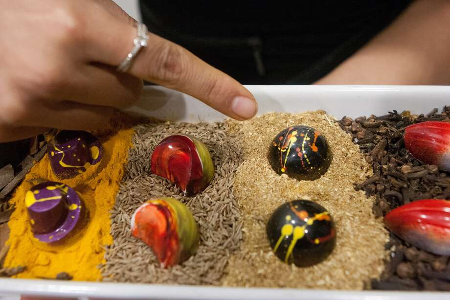 Chocolates by Cacao & Cardamom owner Annie Rupani display a riot of color and unconventional mixes of exotic flavors. Photo: R. Clayton McKee, Freelance / © R. Clayton McKee