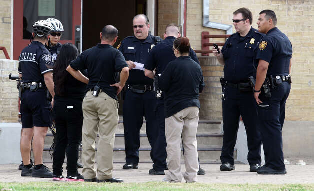 Police investigate at Navarro Academy on the 600 block of South Pecos La Trinidad Tuesday January 29, 2013 where an 17-year-old male showed up at the nurse's office about 11:15 a.m. with stab wounds. The Injuries were non-life threatening and the victim was transported to University Hospital. Photo: JOHN DAVENPORT, San Antonio Express-News / ©San Antonio Express-News/Photo Can Be Sold to the Public