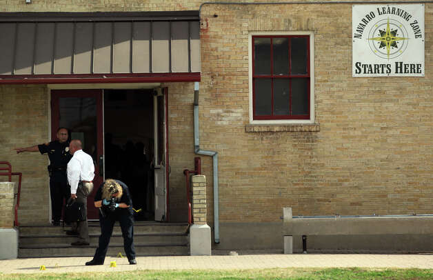Police investigate at Navarro Academy on the 600 block of South Pecos La Trinidad Tuesday January 29, 2013 where an 17-year-old male showed up at the nurse's office about 11:15 a.m. with stab wounds. The Injuries were non-life threatening and the victim was transported to University Hospital. Photo: JOHN DAVENPORT, San Antonio Express-News / © San Antonio Express-News