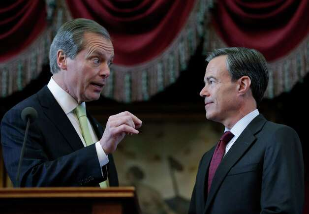 Texas Lt. Gov. David Dewhurst, left, talks with Speaker of the House Joe Strauss, right, R-San Antonio, prior to Gov. Rick Perry's state of the state address in the house chambers at the state capitol, Tuesday, Jan. 29, 2013, in Austin, Texas. (AP Photo/Eric Gay) Photo: Eric Gay, Associated Press / AP