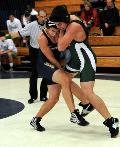 Weston's Josh Lachs, left, and Norwalk's Danny Leon compete in the 170 lb. weight class during their wrestling meet Saturday, Jan. 26, 2013 at Staples High School in Westport, Conn. Photo: Autumn Driscoll / Connecticut Post