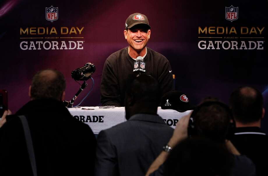 49ers head coach Jim Harbaugh shares a laugh as Media Day gets underway at the Mercedes-Benz Superdome the site of this year's Superbowl between the San Francisco 49ers and the Baltimore Ravens in New Orleans, La. on Tues. Jan. 29, 2013. Photo: Michael Macor, The Chronicle / ONLINE_YES