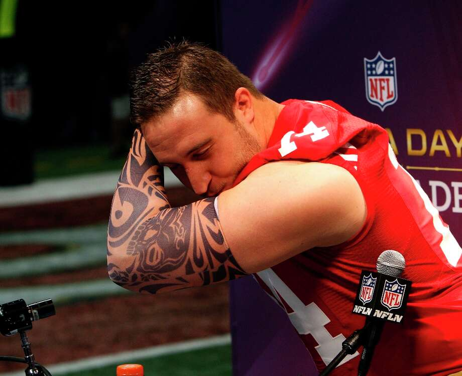 Joe Staley Kaepernicks with a fake tattoo sleeve as he is interviewed while the 49ers attended media day at the Super Dome in New Orleans, La., on Tuesday, January 29, 2013, as part of the Super Bowl festivities. Photo: Carlos Avila Gonzalez, The Chronicle / ONLINE_YES