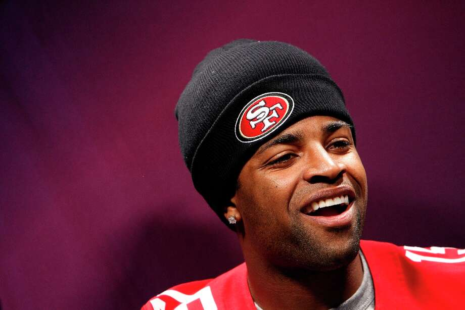 Michael Crabtree answers questions from the press as The 49ers attended media day at the Super Dome in New Orleans, La., on Tuesday, January 29, 2013, as part of the Super Bowl festivities. Photo: Carlos Avila Gonzalez, The Chronicle / ONLINE_YES