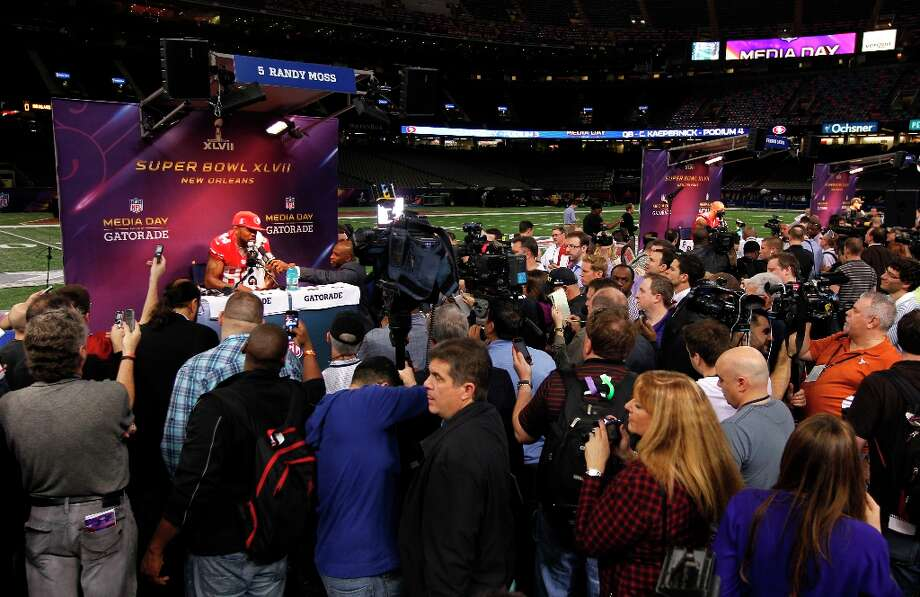 49er Randy Moss,84 talks with reporters as Media Day gets underway at the Mercedes-Benz Superdome the site of this year's Superbowl between the San Francisco 49ers and the Baltimore Ravens in New Orleans, La. on Tues. Jan. 29, 2013. Photo: Michael Macor, The Chronicle / ONLINE_YES