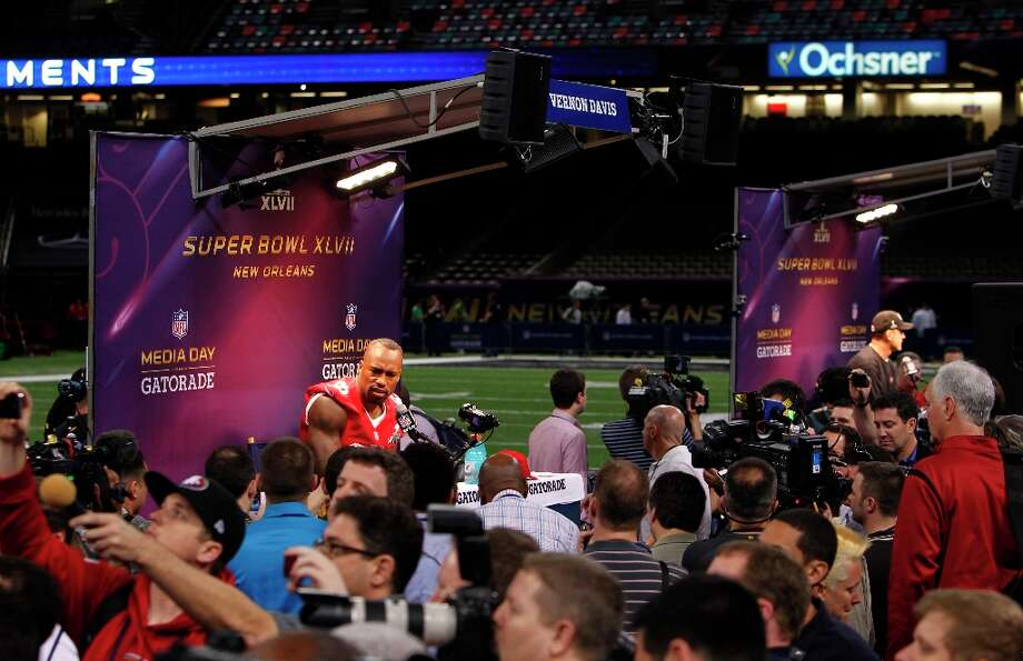 49er Vernon Davis,84 speaks with reporters as Media Day gets underway at the Mercedes-Benz Superdome the site of this year's Superbowl between the San Francisco 49ers and the Baltimore Ravens in New Orleans, La. on Tues. Jan. 29, 2013. Photo: Michael Macor, The Chronicle / ONLINE_YES