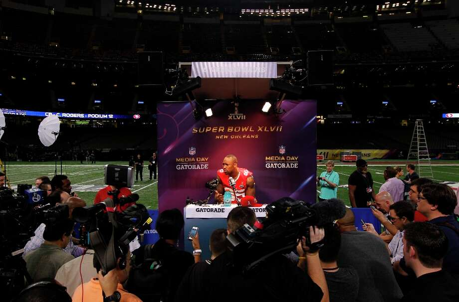 49er Vernon Davis,85 speaks with reporters as Media Day gets underway at the Mercedes-Benz Superdome the site of this year's Superbowl between the San Francisco 49ers and the Baltimore Ravens in New Orleans, La. on Tues. Jan. 29, 2013. Photo: Michael Macor, The Chronicle / ONLINE_YES