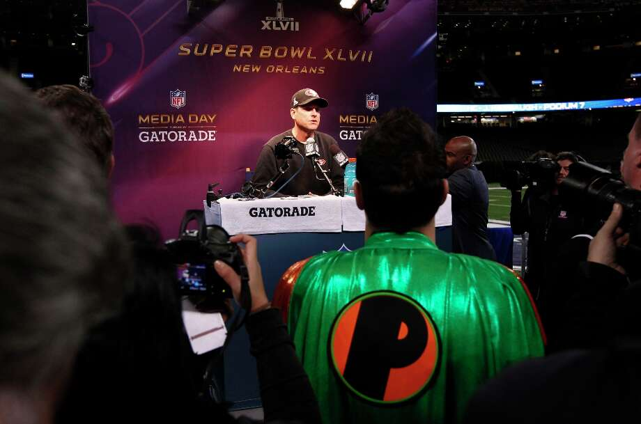 49er head coach Jim Harbaugh talks with reporters as Media Day gets underway at the Mercedes-Benz Superdome the site of this year's Superbowl between the San Francisco 49ers and the Baltimore Ravens in New Orleans, La. on Tues. Jan. 29, 2013. Photo: Michael Macor, The Chronicle / ONLINE_YES