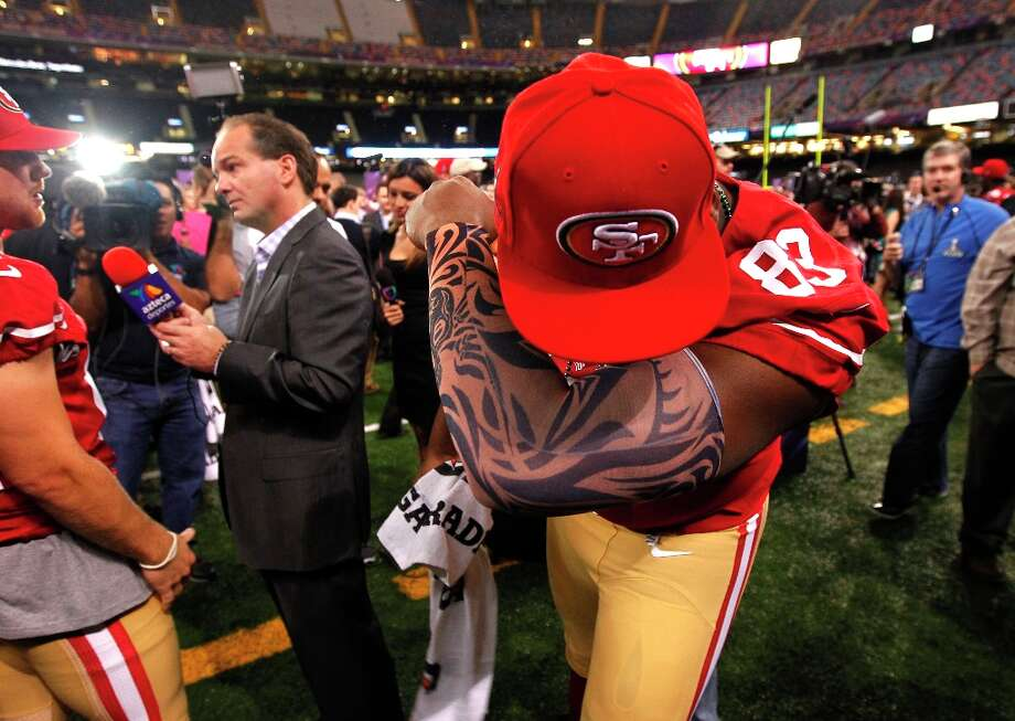 Demarcus Dobbs, 83( on injured reserve) displays his Kaepernicking move as Media Day gets underway at the Mercedes-Benz Superdome the site of this year's Superbowl between the San Francisco 49ers and the Baltimore Ravens in New Orleans, La. on Tues. Jan. 29, 2013. Photo: Michael Macor, The Chronicle / ONLINE_YES