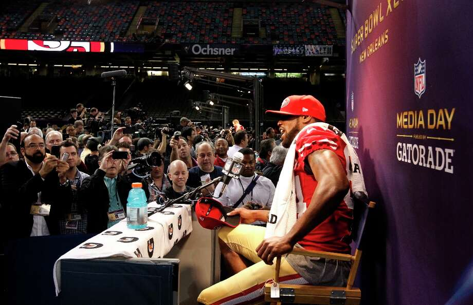 49er Randy Moss, 84 contemplates a question from a reporter as Media Day gets underway at the Mercedes-Benz Superdome the site of this year's Superbowl between the San Francisco 49ers and the Baltimore Ravens in New Orleans, La. on Tues. Jan. 29, 2013. Photo: Michael Macor, The Chronicle / ONLINE_YES