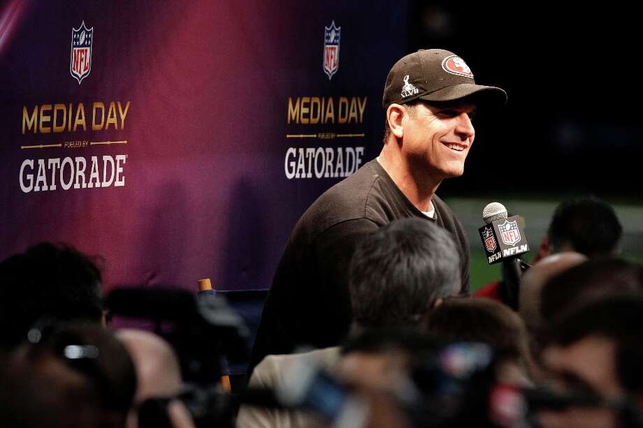 49er head coach Jim Harbaugh speaks to reporters as Media Day gets underway at the Mercedes-Benz Superdome the site of this year's Superbowl between the San Francisco 49ers and the Baltimore Ravens in New Orleans, La. on Tues. Jan. 29, 2013. Photo: Michael Macor, The Chronicle / ONLINE_YES