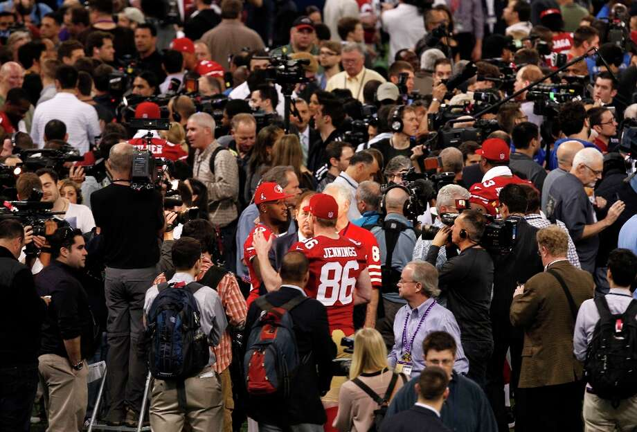 49ers A. J. Jenkins, (17) and Brian Jennings(86) are surrounded as Media Day gets underway at the Mercedes-Benz Superdome the site of this year's Superbowl between the San Francisco 49ers and the Baltimore Ravens in New Orleans, La. on Tues. Jan. 29, 2013. Photo: Michael Macor, The Chronicle / ONLINE_YES