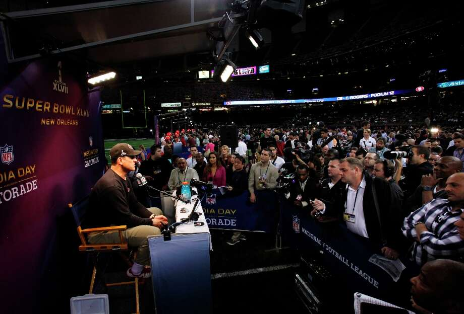 49ers head coach Jim Harbaugh speaks to the press as the 49ers attended media day at the Super Dome in New Orleans, La., on Tuesday, January 29, 2013, as part of the Super Bowl festivities. Photo: Carlos Avila Gonzalez, The Chronicle / ONLINE_YES