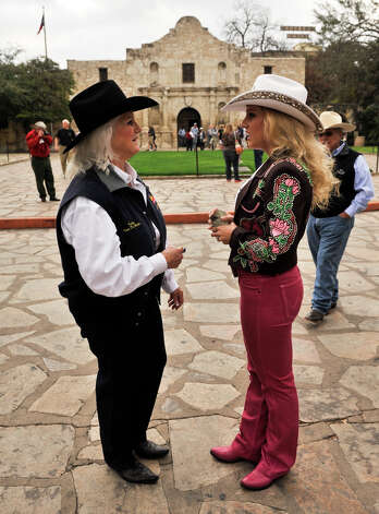 Jackie Vandewalle, Assistant Vice-President of the San Antonio Stock Show and Rodeo and Miss Rodeo Texas 2013 Rosanna Pace speak following a public relations event Tuesday on Alamo Plaza.The event announced the 2013 Western Heritage Parade and Cattle Drive that will be this  Saturday downtown. Photo: Robin Jerstad