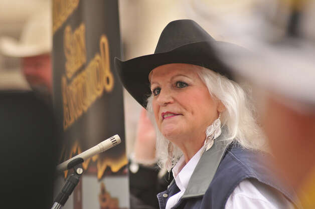 Jackie Vandewalle, Assistant Vice-President of the San Antonio Stock Show and Rodeo speaks during a public relations event Tuesday on Alamo Plaza.The event announced the 2013 Western Heritage Parade and Cattle Drive that will be this  Saturday downtown. Photo: Robin Jerstad