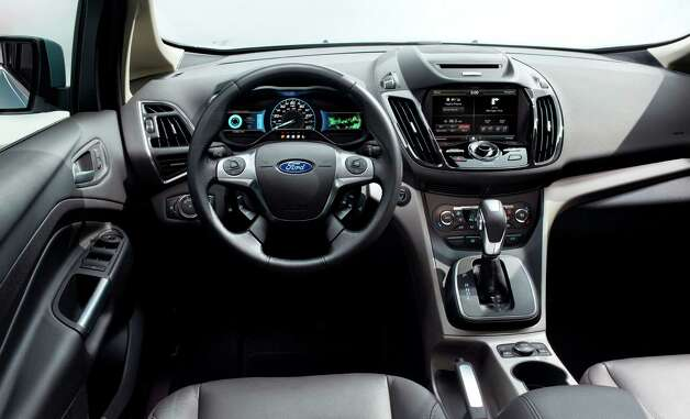 In an undated handout photo, the interior of the 2013 Ford C-Max Hybrid. Ford made the American-market C-Max into the company's first exclusively hybrid model, with a plug-in version, called the C-Max Energi, and a standard gas-electric C-Max Hybrid. (Ford Motor via The New York Times) -- NO SALES; FOR EDITORIAL USE ONLY WITH STORY SLUGGED AUTOS FORD CMAX ADV27 BY BRADLEY BERMAN. ALL OTHER USE PROHIBITED. Photo: FORD MOTOR, New York Times / FORD MOTOR