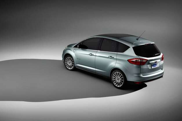In an undated handout photo, the 2013 Ford C-Max Energi. Ford made the American-market C-Max into the company's first exclusively hybrid model, with a plug-in version, called the C-Max Energi, and a standard gas-electric C-Max Hybrid. (Ford Motor via The New York Times) -- NO SALES; FOR EDITORIAL USE ONLY WITH STORY SLUGGED AUTOS FORD CMAX ADV27 BY BRADLEY BERMAN. ALL OTHER USE PROHIBITED. Photo: FORD MOTOR, New York Times / FORD MOTOR