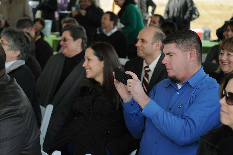 Richard Newman, right, with wife Tristan Newman attend the groundbreaking ceremony of  Dylan's Park, named for his son, Dylan, who died at age 2 in 2008, and also the adjoining Spring Skate Park. Photo: Jerry Baker, Freelance