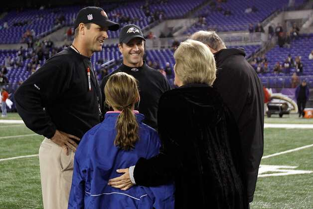 How long will the postgame handshake/hug last between Jim and John Harbaugh? Line: Over/under 7.5 seconds Photo: Rob Carr, Getty Images