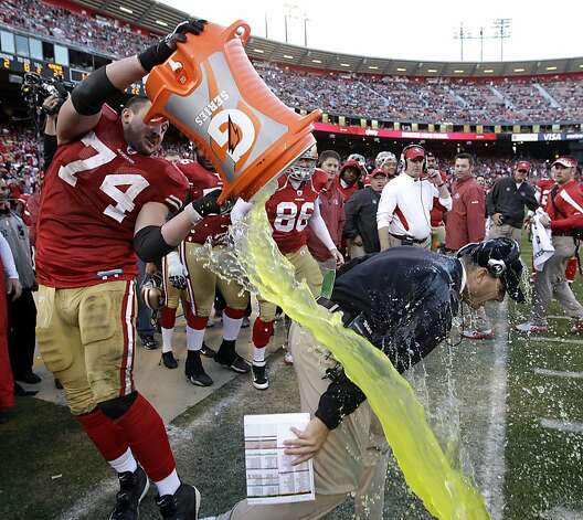 What color will the Gatorade (or liquid) be that is dumped on the winning coach? Line: Clear/Water (7/4), Orange (5/2), Yellow (5/2), Green (13/2), Red (13/2) Blue (13/2) Photo: Paul Sakuma, AP