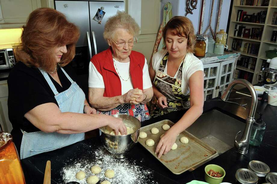 From left: Karen Rittinger, her mother Elsie Monk and granddaughter Victoria make kolaches at Victoria's downtown loft Sunday Sept. 30,2012.(Dave Rossman photo) Photo: Dave Rossman, For The Houston Chronicle / © 2012 Dave Rossman