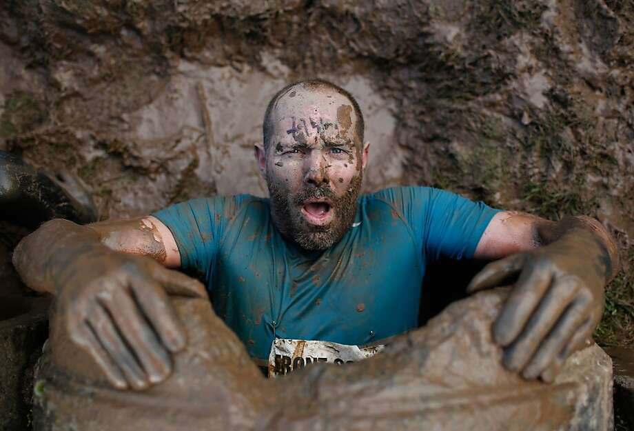 We got a gopher:A competitor emerges from an underground tunnel during the Tough Guy Challenge in Telford, England. Photo: Harry Engels, Getty Images