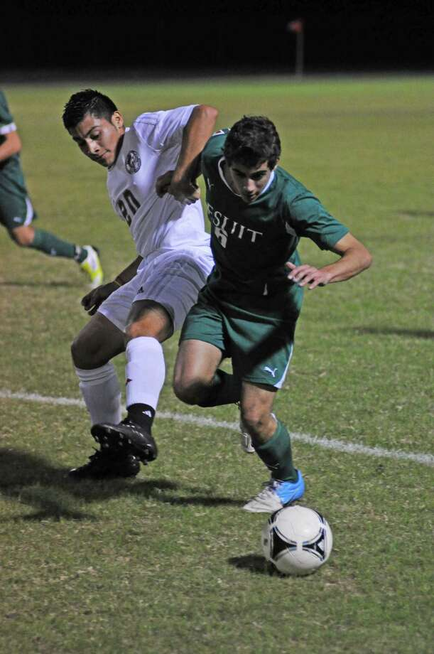 Cy Lakes junior Cristian Villatoro (20 at left) battles with Strake Jesuit junior Aaron Gisser (6 at right) in a 2-0 Crusader win earlier this season. The pair meet again in the area round of the playoffs Friday. Photo: L. Scott Hainline, Freelance / Freelance