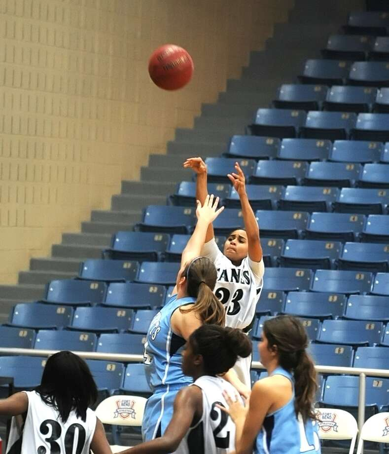 Hightower's Adrianna Wooten (23) jumps over the defense of Clements and attempts a three point shot during a Hurricane win. Photo: Eddy Matchette, Freelance / Freelance