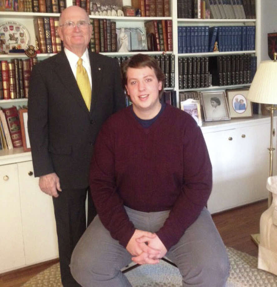 New Canaan High School senior Bobby Erickson is collecting bed sheets for earthquake victims in Haiti as his Eagle Scout project. Erickson is shown with Dr. Thomas Flynn, who is helping sponsor the project. Photo: Contributed Photo