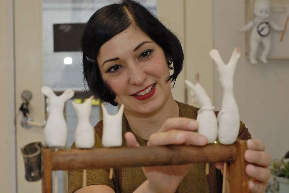 "Stephanie Lienhard with a few of her ""Little Creatures"" clay figurines at the Sparrow and the Nest shop. Photo:  Tony Bullard 2012, Freelance Photographer / © Tony Bullard & the Houston Chronicle"