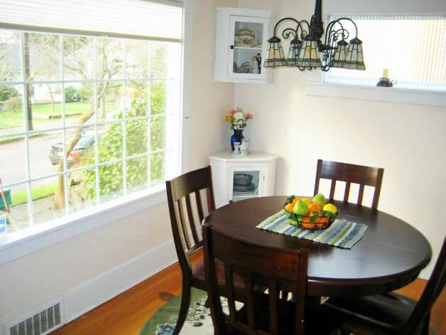 Dining room of 6522 30th Ave. N.E. The 2,280-square-foot house, built in 1924, has three bedrooms, 1.75 bathrooms, arched doorways, coved crown moldings, a family room, a front porch and a back deck on a 4,500-square-foot lot. It's listed for $500,000. Photo: Courtesy Ken Shiovitz/Windermere Real Estate