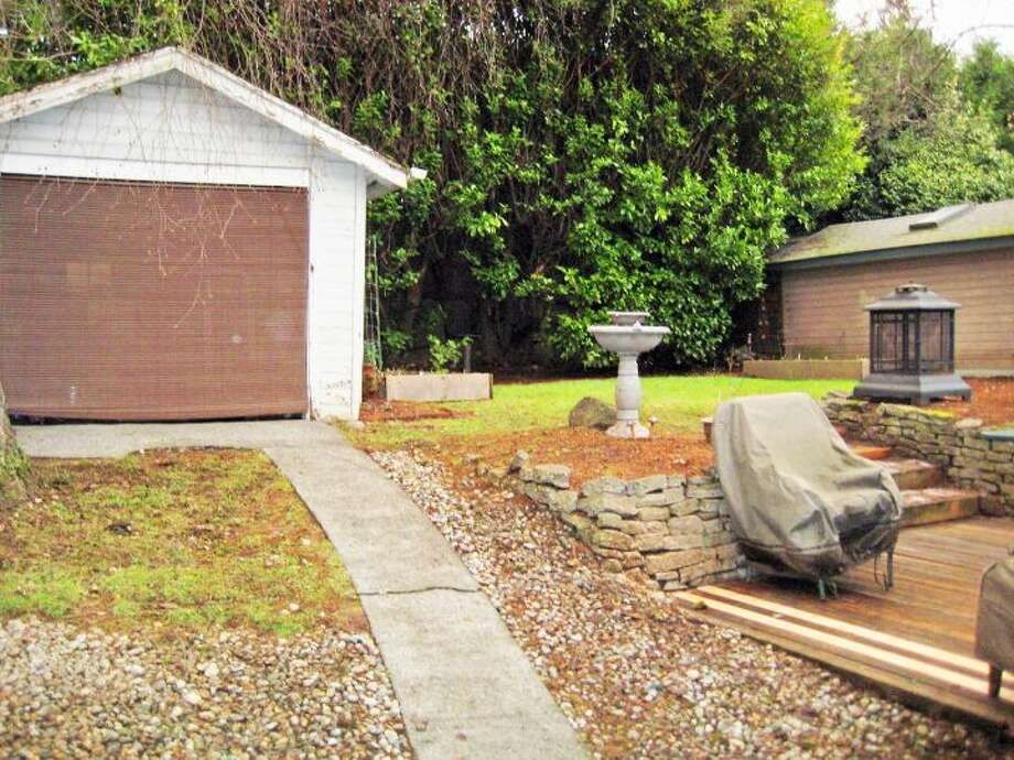 Back yard of 6522 30th Ave. N.E. The 2,280-square-foot house, built in 1924, has three bedrooms, 1.75 bathrooms, arched doorways, coved crown moldings, a family room, a front porch and a back deck on a 4,500-square-foot lot. It's listed for $500,000. Photo: Courtesy Ken Shiovitz/Windermere Real Estate