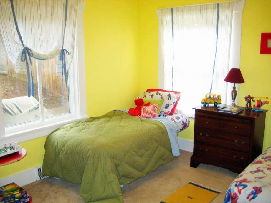 Bedroom of 6522 30th Ave. N.E. The 2,280-square-foot house, built in 1924, has three bedrooms, 1.75 bathrooms, arched doorways, coved crown moldings, a family room, a front porch and a back deck on a 4,500-square-foot lot. It's listed for $500,000. Photo: Courtesy Ken Shiovitz/Windermere Real Estate