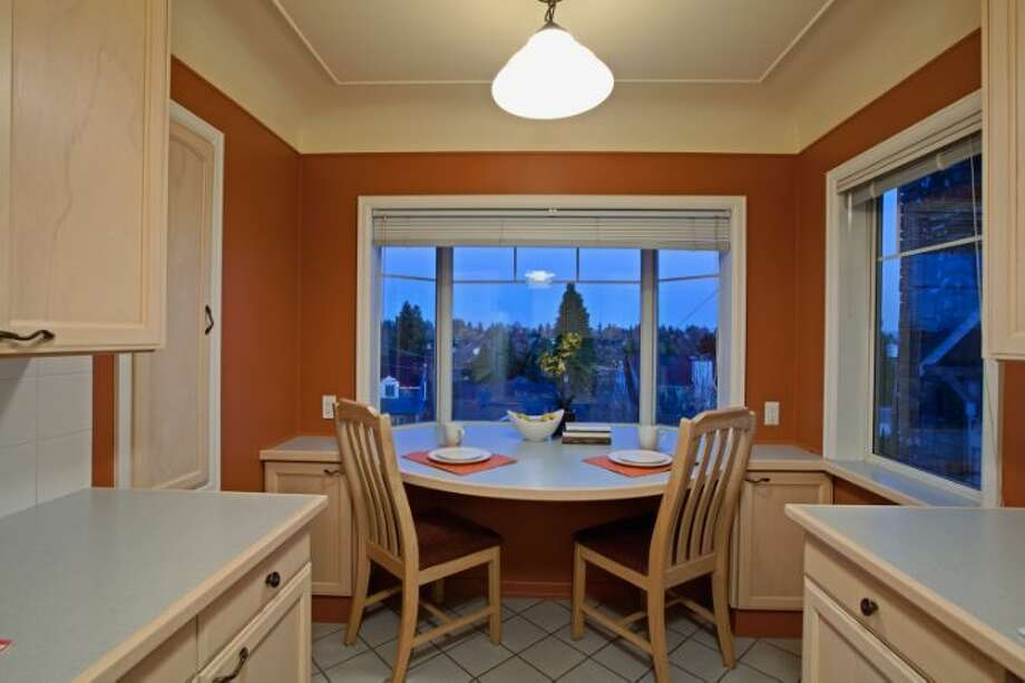 Breakfast nook of 7327 19th Ave. N.E. The 1,850-square-foot house, built in 1929, has two bedrooms, 1.75 bathrooms, a family room, coved ceilings, French doors, a front porch and a patio on a terraced, 3,060-square-foot view lot. It's listed for $499,900. Photo: Courtesy Bruce Johnson And Lisa Strain/Windermere Real Estate