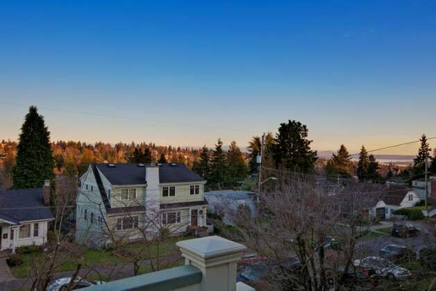 View from 7327 19th Ave. N.E. The 1,850-square-foot house, built in 1929, has two bedrooms, 1.75 bathrooms, a family room, coved ceilings, French doors, a front porch and a patio on a terraced, 3,060-square-foot lot. It's listed for $499,900. Photo: Courtesy Bruce Johnson And Lisa Strain/Windermere Real Estate