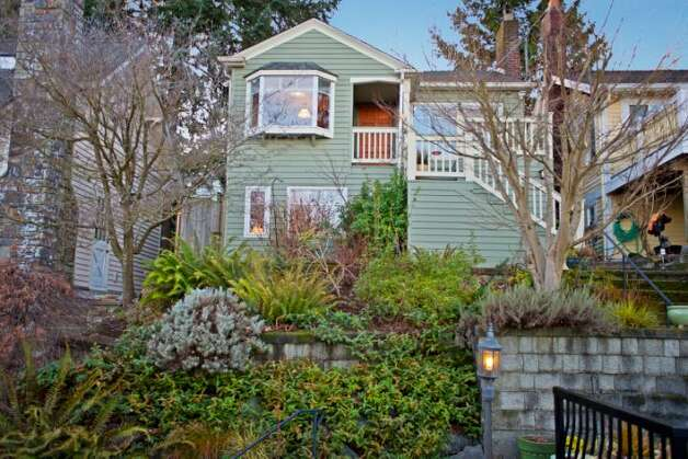 Our next home, 7327 19th Ave. N.E., is listed for just under $500,000, at $499,900. The 1,850-square-foot house, built in 1929, has two bedrooms, 1.75 bathrooms, a family room, coved ceilings, French doors, a front porch and a patio on a terraced, 3,060-square-foot view lot. Photo: Courtesy Bruce Johnson And Lisa Strain/Windermere Real Estate