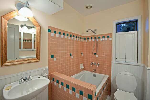 Bathroom of 7327 19th Ave. N.E. The 1,850-square-foot house, built in 1929, has two bedrooms, 1.75 bathrooms, a family room, coved ceilings, French doors, a front porch and a patio on a terraced, 3,060-square-foot view lot. It's listed for $499,900. Photo: Courtesy Bruce Johnson And Lisa Strain/Windermere Real Estate