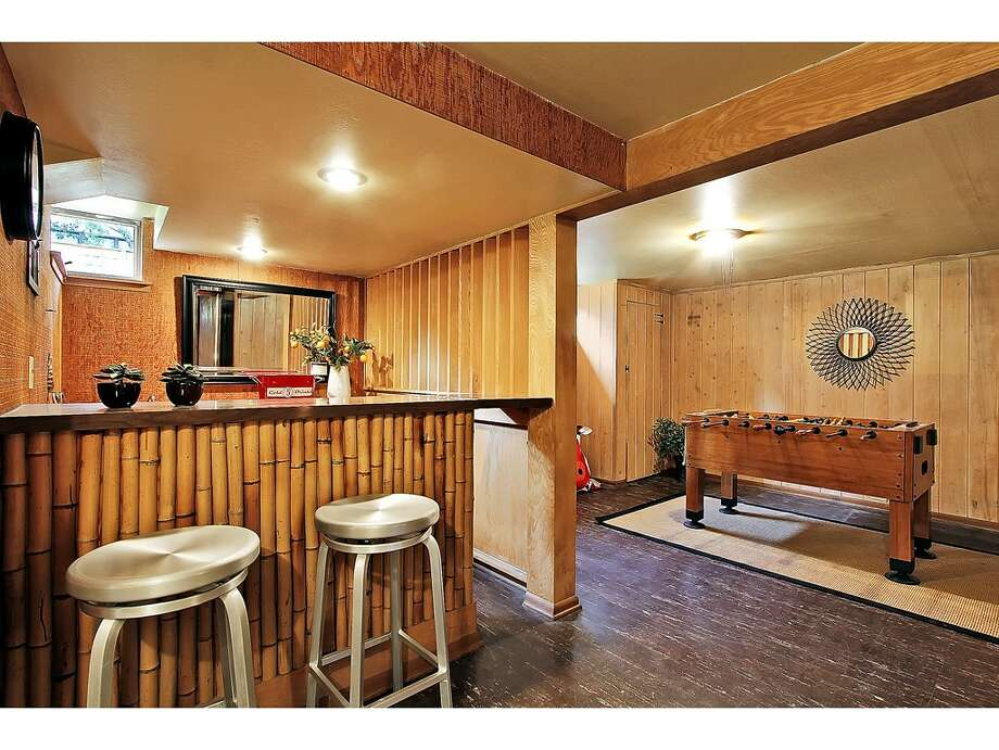 Rec room of 6559 36th Ave. N.E. The 2,520-square-foot house, built in 1954, has three bedrooms, 1.75 bathrooms, big windows, and views of the Cascades on a 5,100-square-foot lot. It's listed for $525,000. Photo: Courtesy Carolyn Holm/Windermere Real Estate