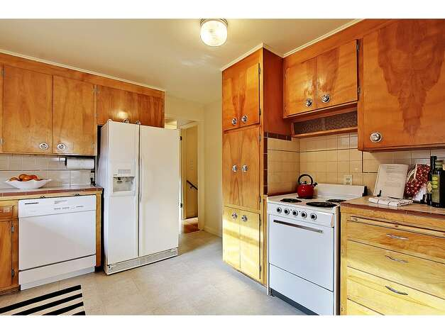 Kitchen of 6559 36th Ave. N.E. The 2,520-square-foot house, built in 1954, has three bedrooms, 1.75 bathrooms, big windows, a rec room with a fireplace and bar, and views of the Cascades on a 5,100-square-foot lot. It's listed for $525,000. Photo: Courtesy Carolyn Holm/Windermere Real Estate